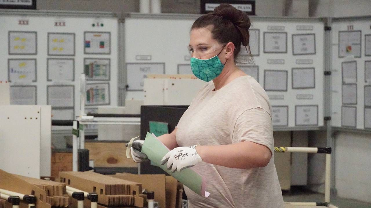 One Herman Miller factory worker wearing protective gear, older workers, ageism, Next Avenue