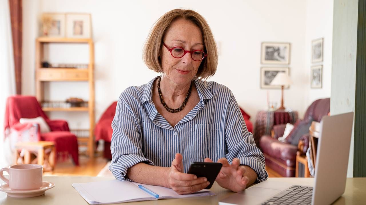 Older woman working from home on her computer, ageism at work, Next Avenue