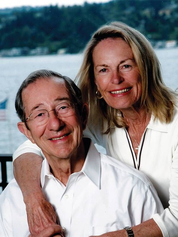 A husband and wife smiling in front of a lake, dementia, Alzheimer's, Next Avenue
