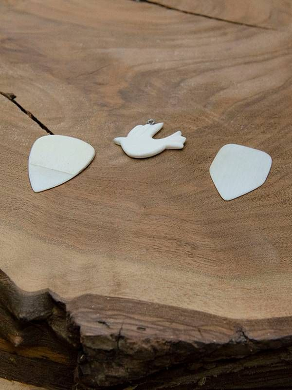 Guitar picks and a dove pendant made from ivory piano keys, restoration, Next Avenue