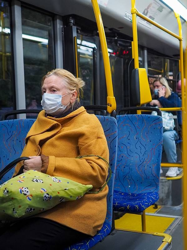 Women wearing face masks on the bus, post-pandemic, COVID-19,  Next Avenue