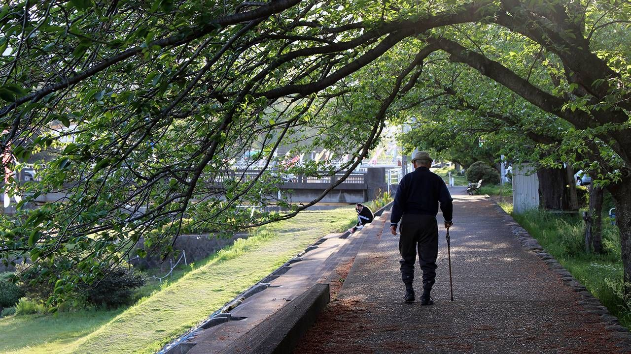 Older man walking alone, end of life, life stages, Next Avenue