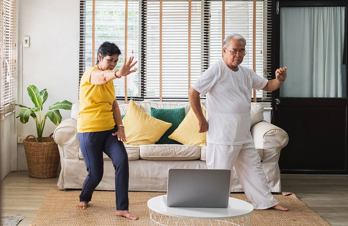 Couple doing Tai-Chi at home, independent living, Next Avenue