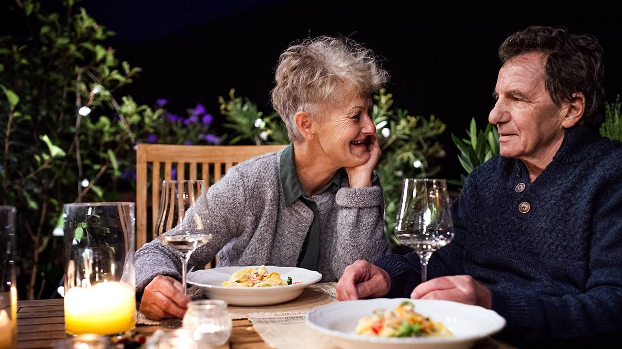 Couple eating dinner, money, finances, relationship, Next Avenue