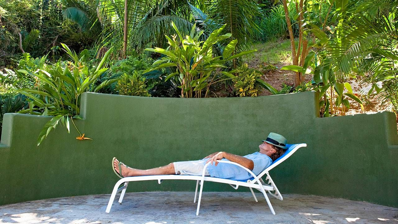 An older man napping in a chaise lounge outside, naps, sleep science, Next Avenue