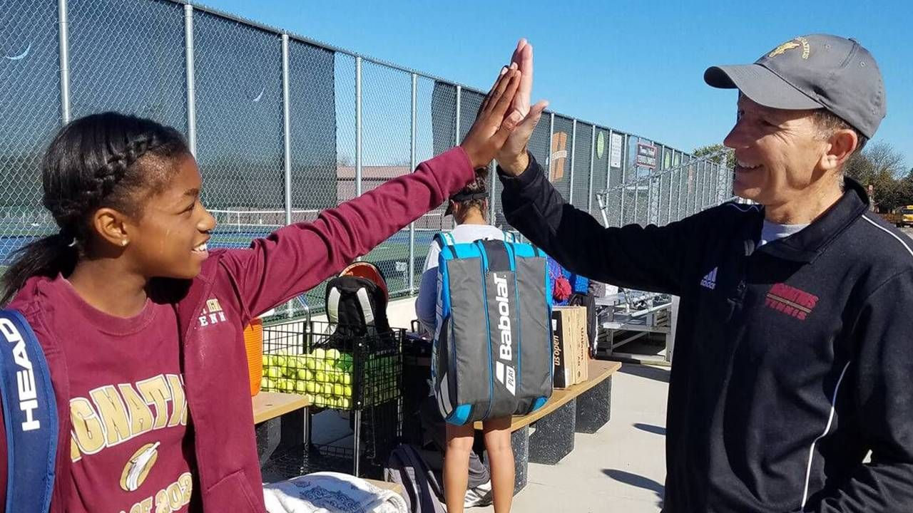 Tennis instructor with young athlete, Career pivot, second act, Next Avenue
