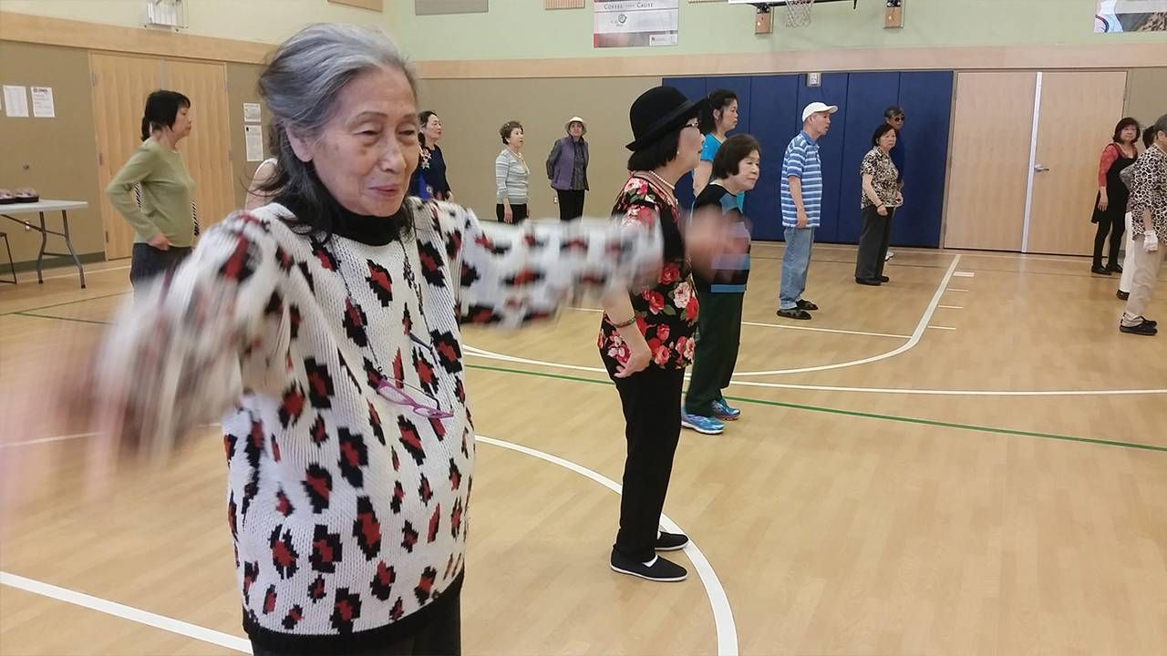 A group of older adults with in a gymnasium, dementia, Alzheimer's, Next Avenue