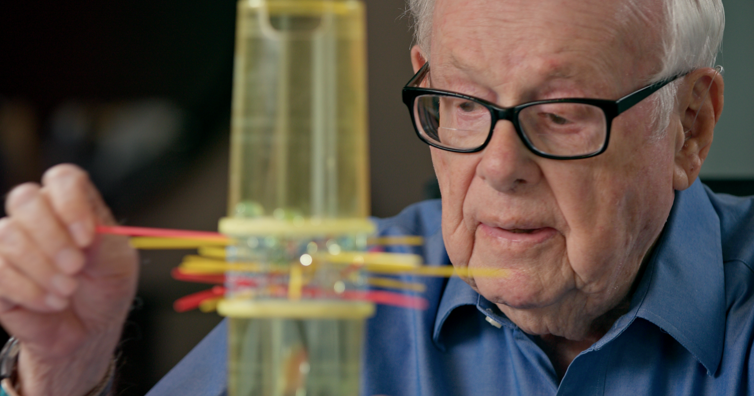 Eddy playing Kerplunk, toy inventor, documentary, Next Avenue