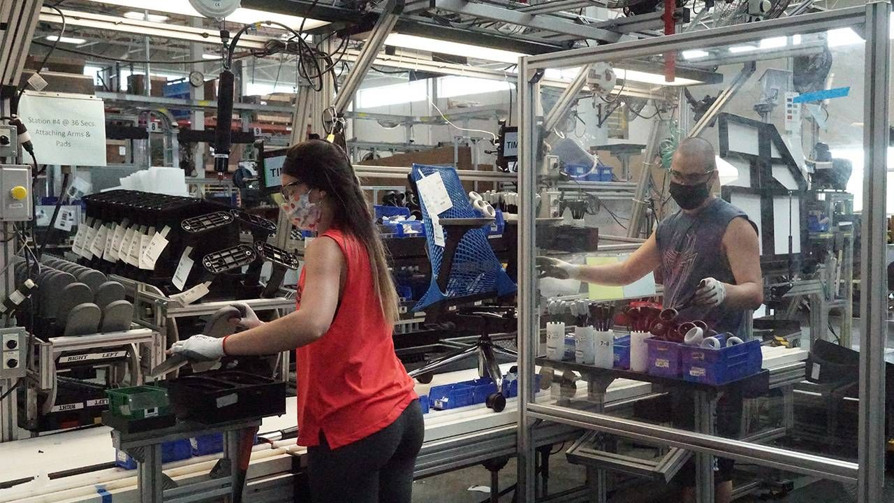 Two factory workers at the Herman Miller factory, older workers, ageism, Next Avenue