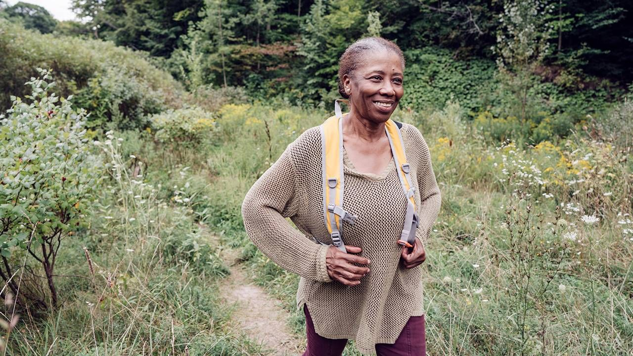 woman hiking in nature, heart health, women, Next Avenue