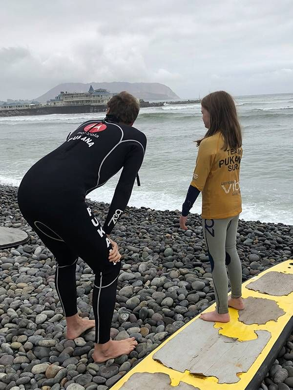 Father and daughter at the beach surfing, beginners, lifelong learning, Next Avenue
