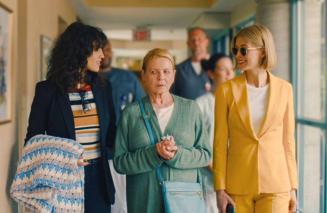 Still from 'I Care A Lot' film actors walking down hallway, conservatorship, Next Avenue