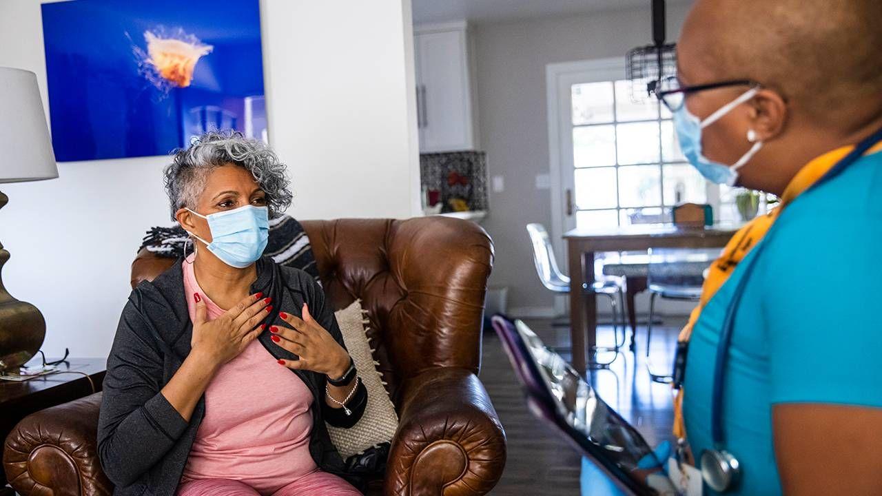 Black nurse visits patient during home care visit, disparities, dementia care, Next Avenue