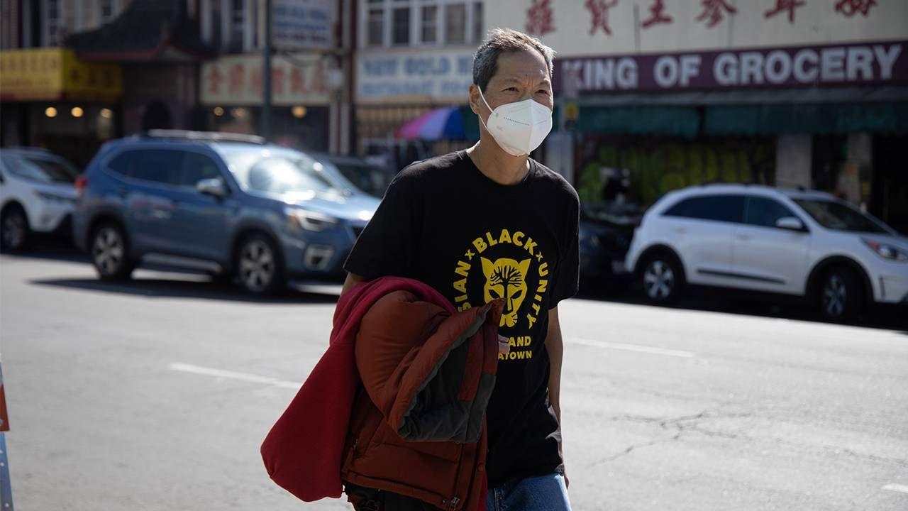 Older man walking down street in chinatown, hate crimes, activism, Next Avenue