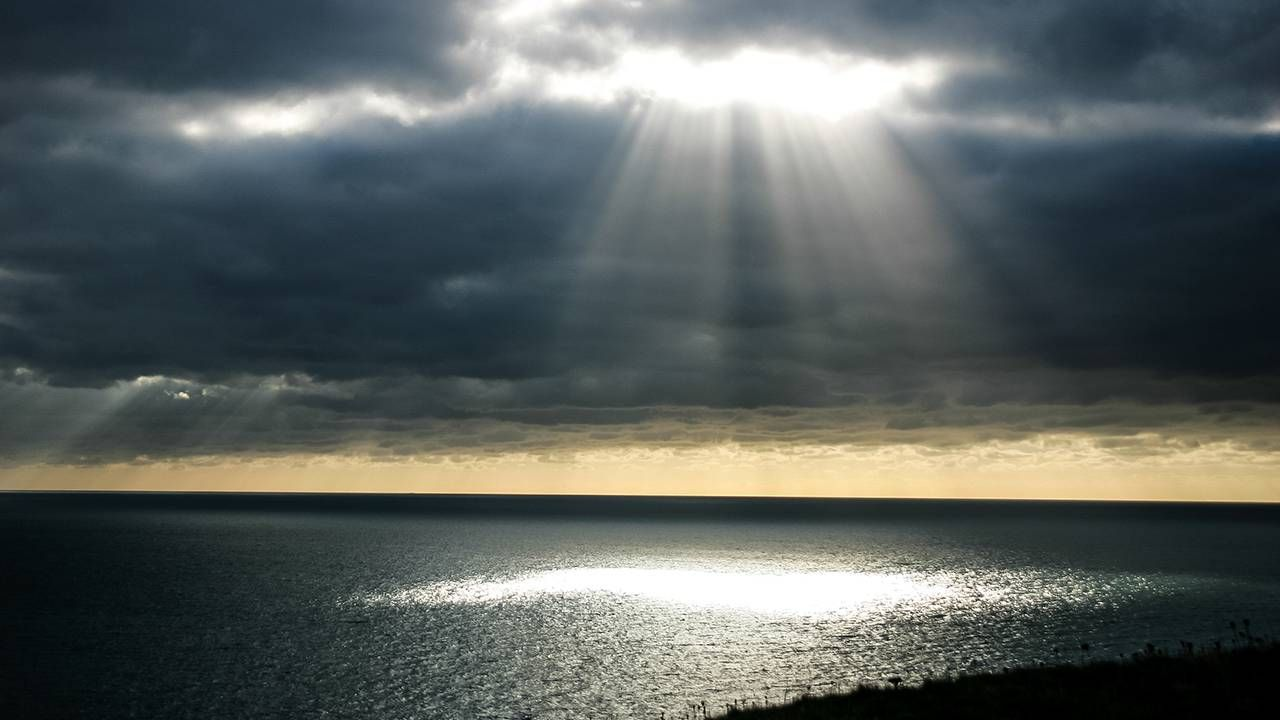 Sun beam breaking through clouds, pandemic, silver linings, Next Avenue