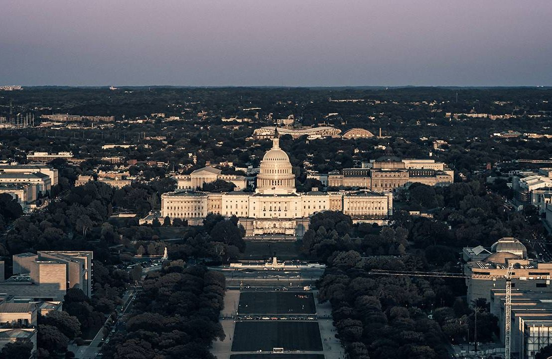 Aerial view of Washington D.C. Capitol building at sunset, law, health, Next Avenue
