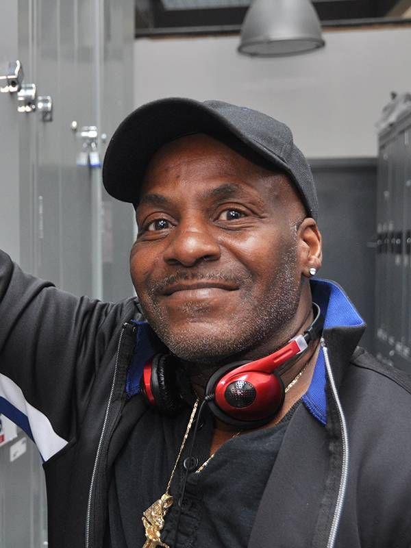 Middle age man wearing headphones inside a locker room at work, jobs, Next Avenue