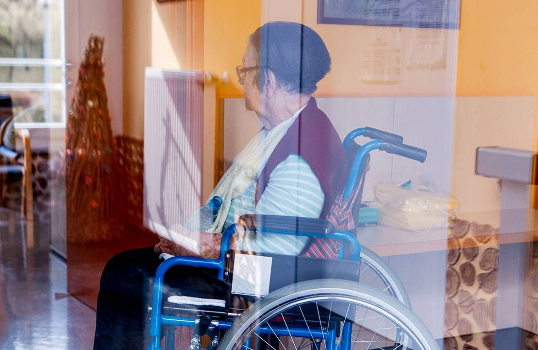 Nursing home, Next Avenue, Older woman using wheelchair in nursing home, Next Avenue