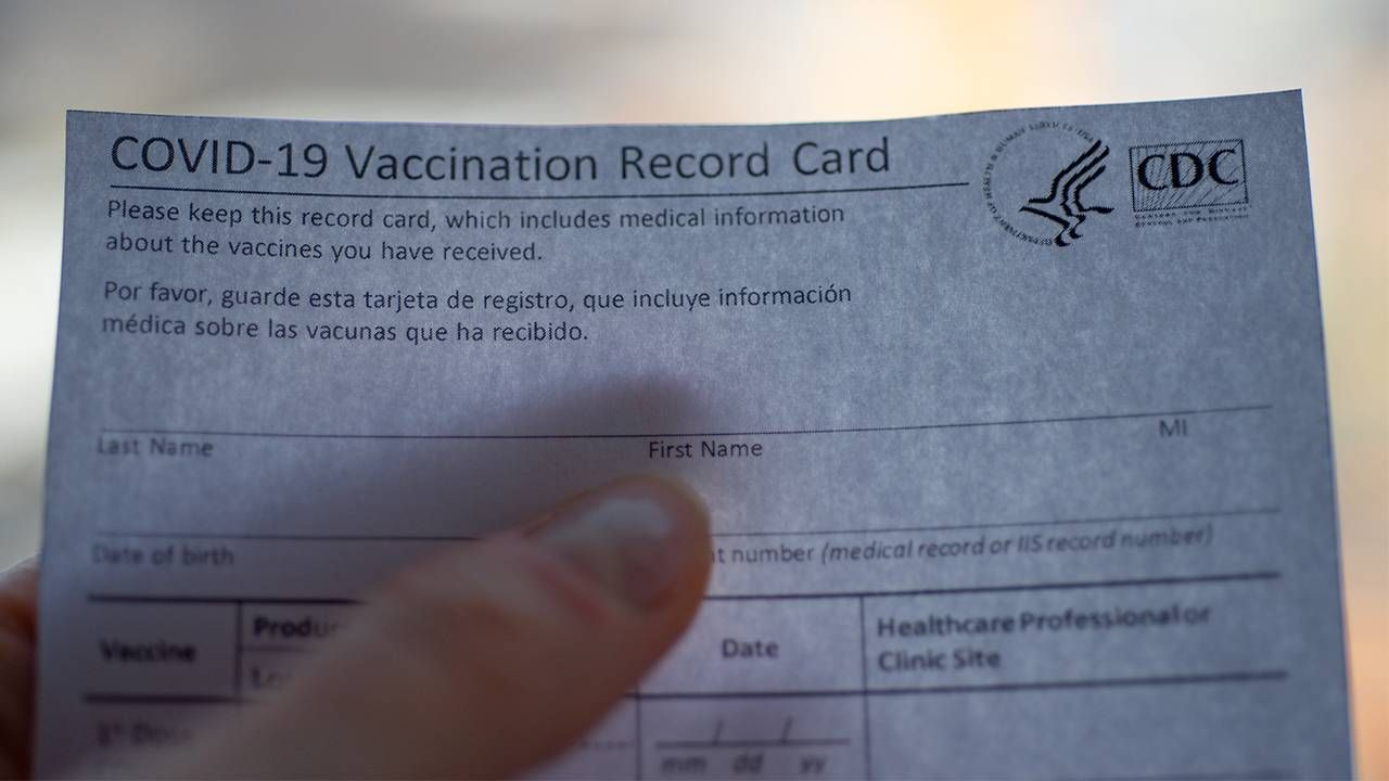 COVID-19 vaccination record card from CDC, vaccine hesitancy, Next Avenue