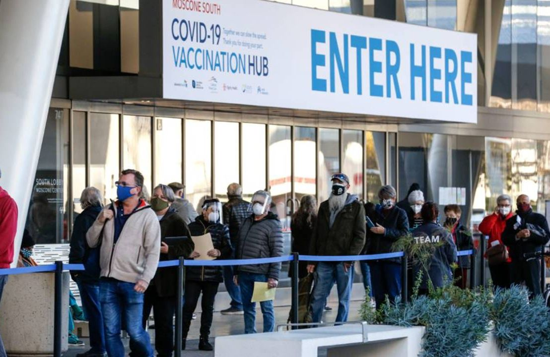 COVID-19 vaccine, People in line outside to get COVID-19 vaccine, Next Avenue