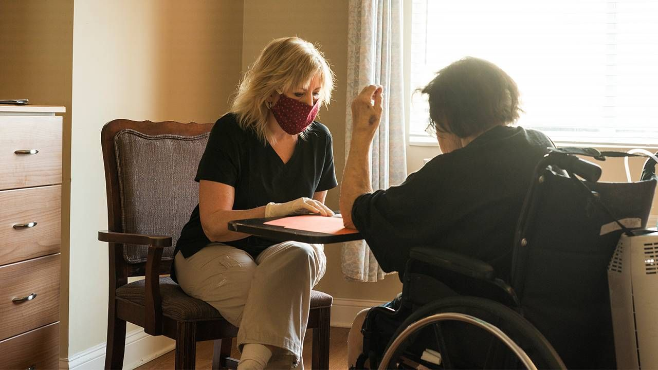 Home health aide meets with a patient, jobs, work, pandemic, Next Avenue