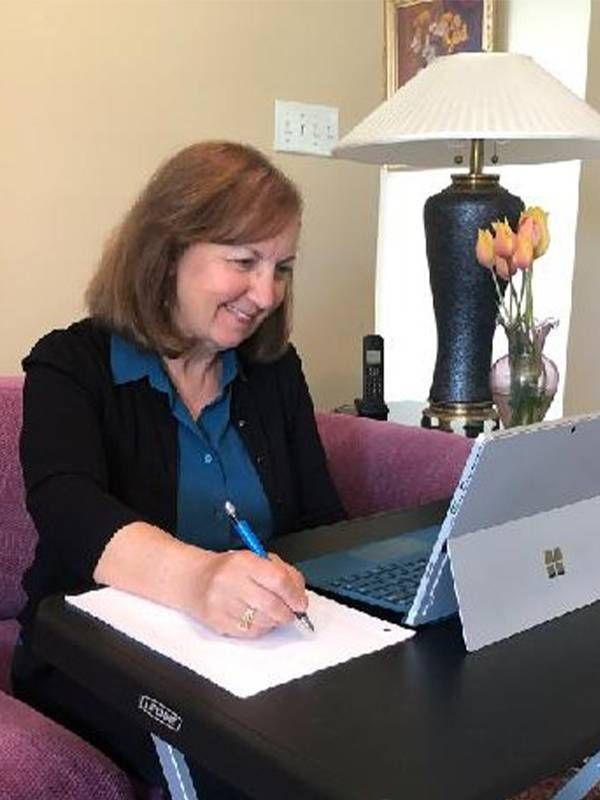 A woman at home providing counseling services over the internet. Freelance jobs, Next Avenue