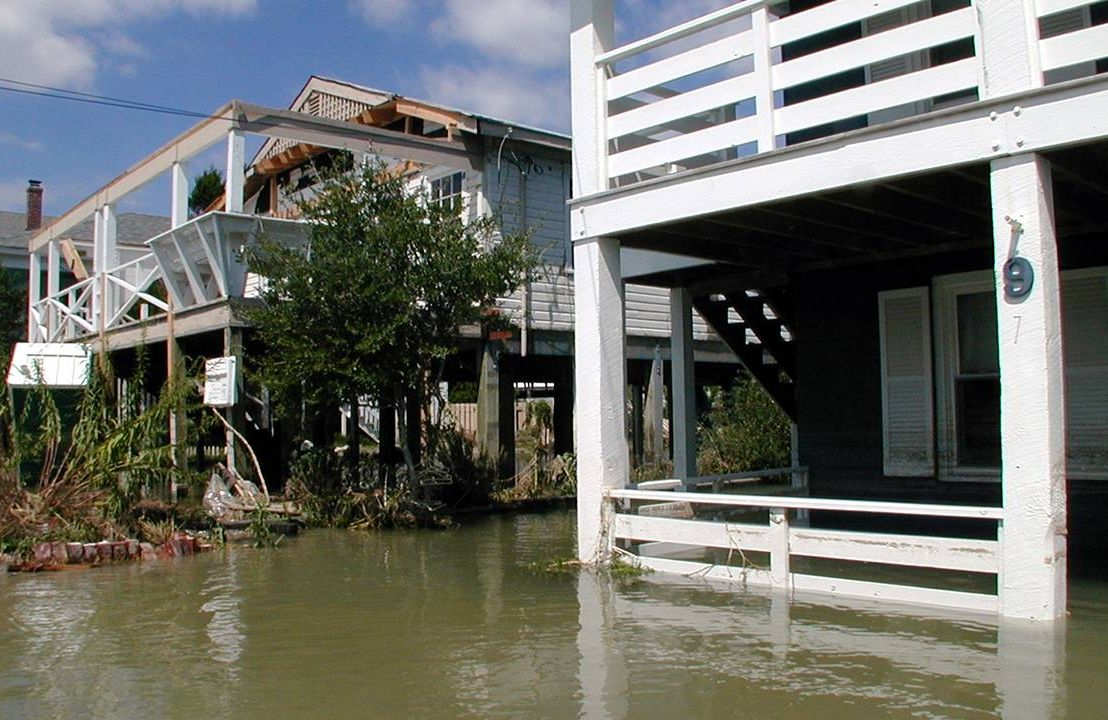 A row of houses on stilts that are heavily flooded, climate change, retirement, Next Avenue