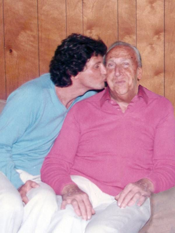 A 1980's photo of the author kissing his father on the cheek, dad, father, memoir, Next Avenue