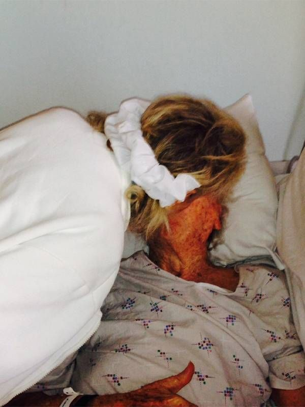 The author's mother kissing his father in the hospital, dad, memoir, Next Avenue