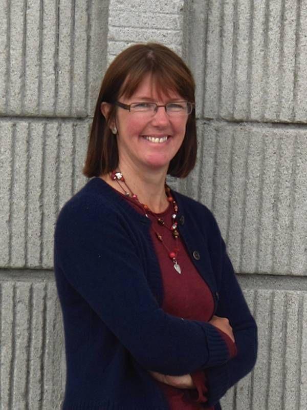 Poet Kathleen Jamie standing outside smiling. Poets, poetry, Next Avenue
