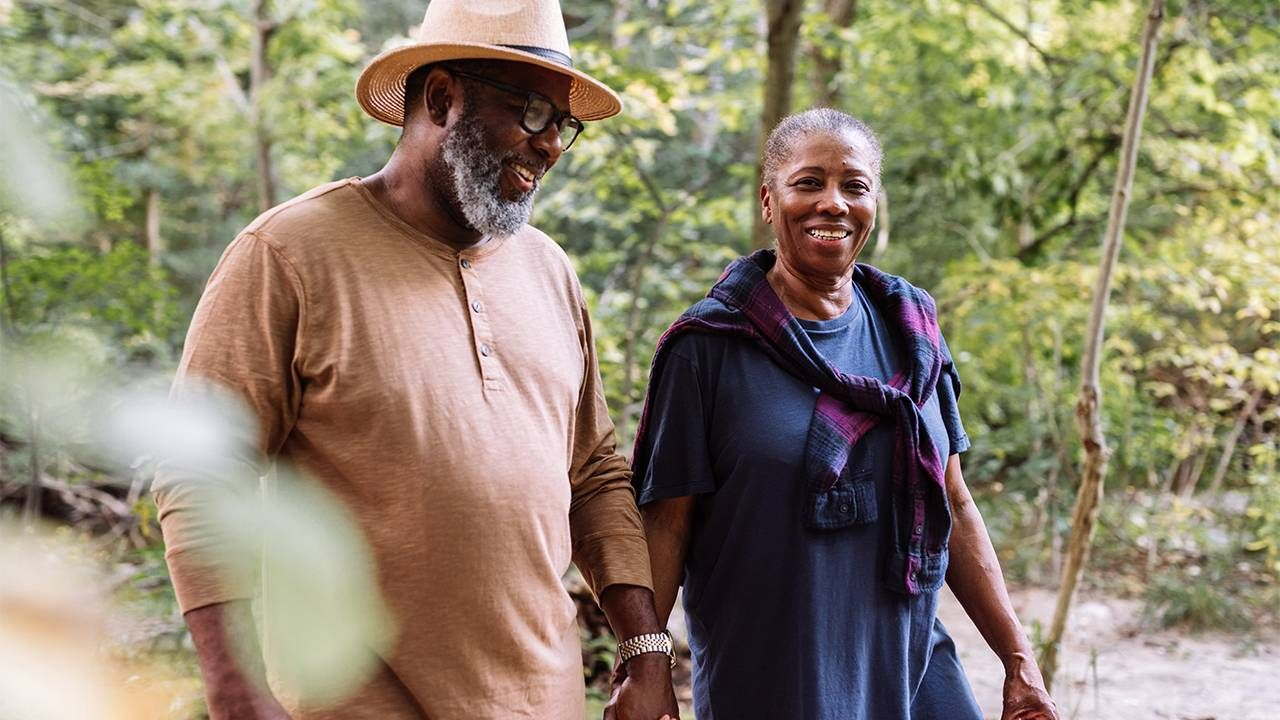 Older retired couple walking in the woods. Retirement, Next Avenue