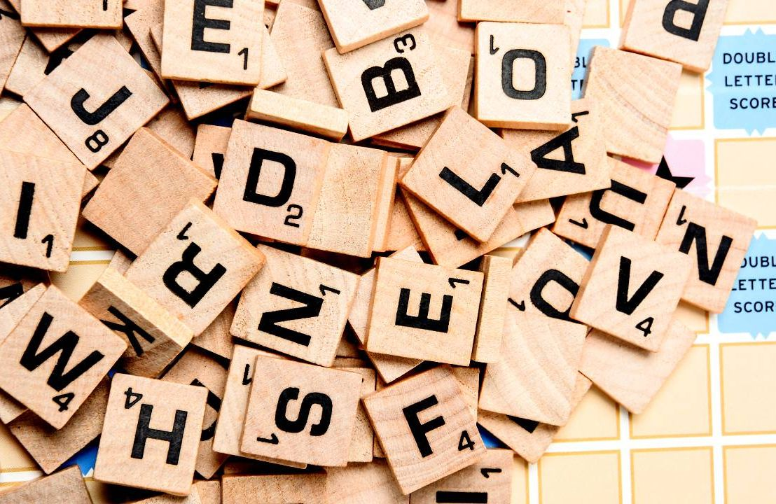 Close up of scrabble letters on top of a scrabble board, Next Avenue