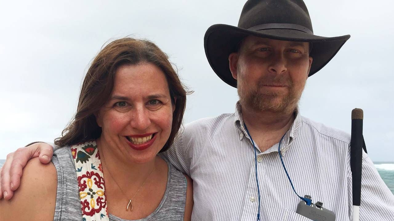 Author, Kate, and her husband smiling on the beach, caregiver, caregiver, burnout, Next Avenue