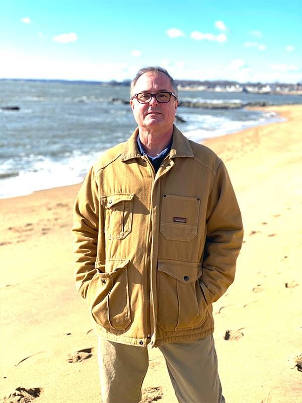 An older man standing on the beach. Nonprofits, Next Avenue