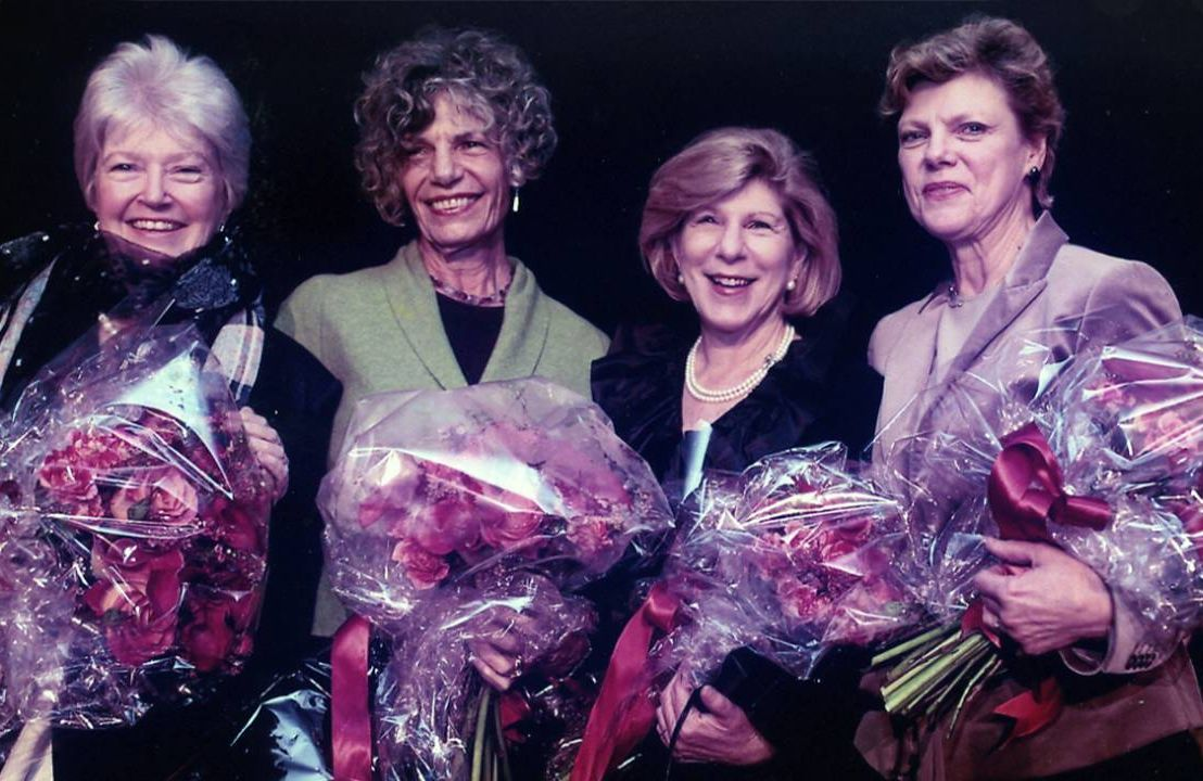 The four founding journalists standing side-by-side holding bouquets of roses. NPR, Founding Mothers, Next Avenue