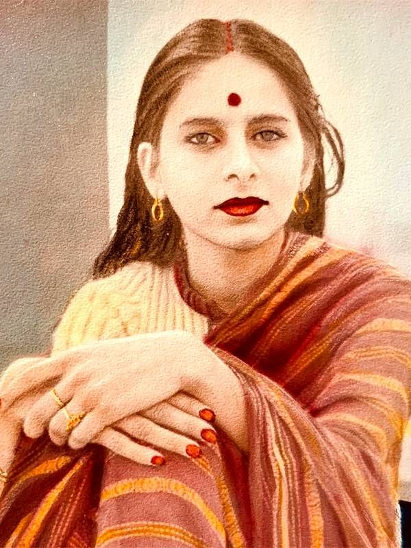 A young woman wearing a red sari and a traditional red bindi. Alka Joshi, Next Avenue, mother