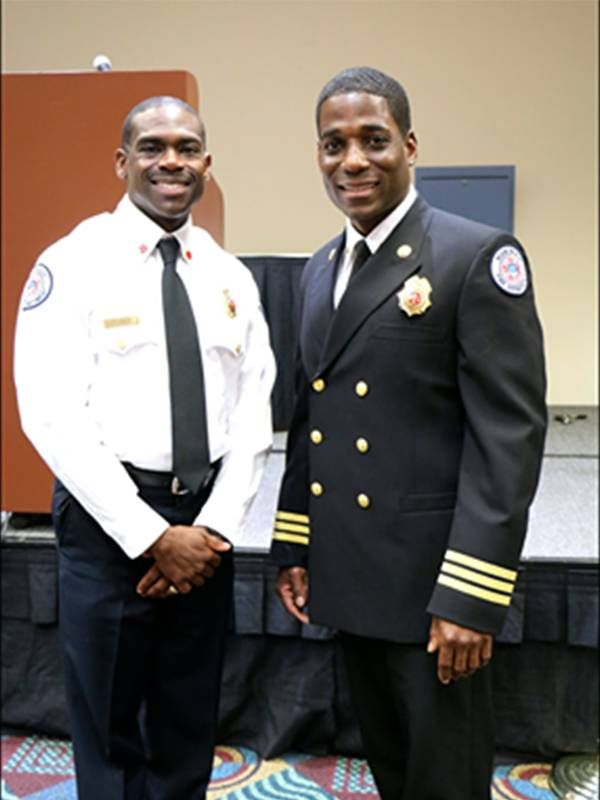 Two fire captains smiling in uniform. Racism, firefighters, Next Avenue