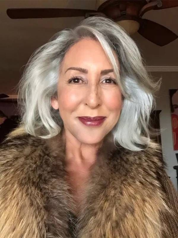 A woman with grey hair wearing a fur coat smiling. Older actors, Next Avenue