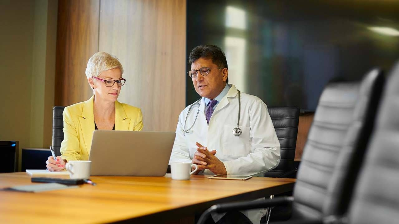 A doctor meeting with a pharmaceutical sales person. Payments, Next Avenue