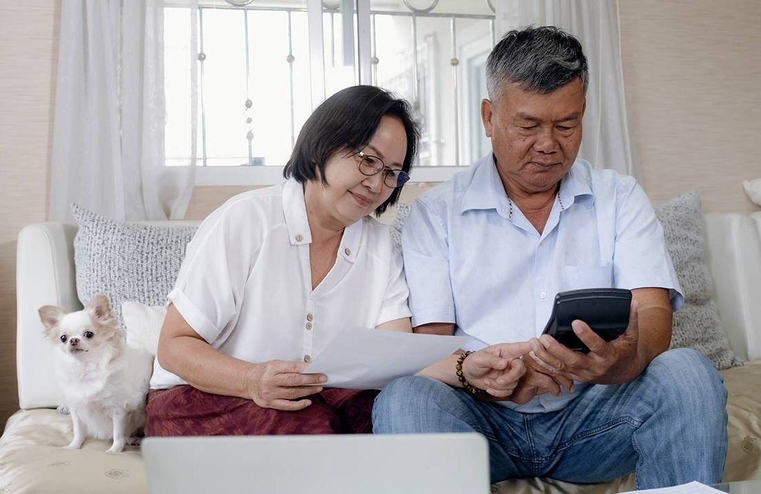 An older couple calculating and planning for retirement.