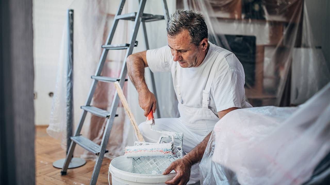A professional painter painting the inside of a home. Freelance jobs, freelancing, Next Avenue