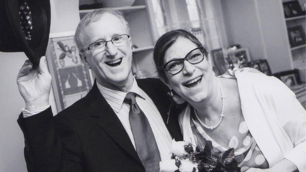 Black and white wedding photo of a smiling, healthy couple, caregiver, caregiving, Next Avenue