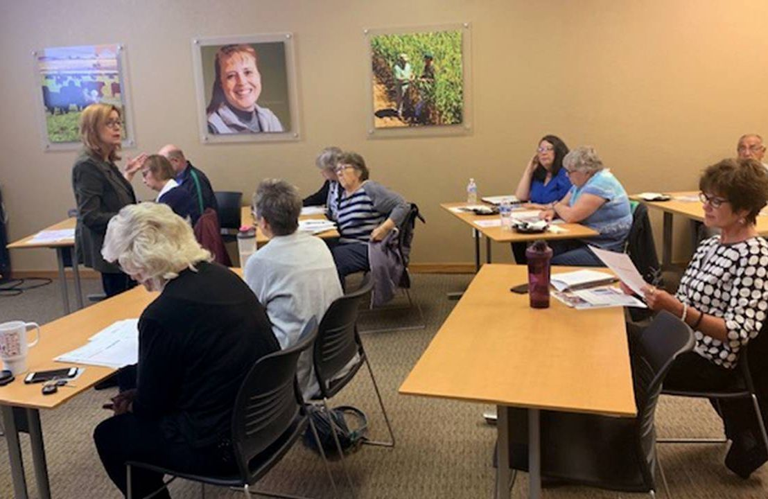 A woman leading a class of older adults. Older workers, age diversity, Colorado, Next Avenue