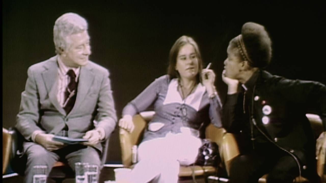 An old photograph of LGBT activists on a TV program. 'CURED' documentary, Next Avenue