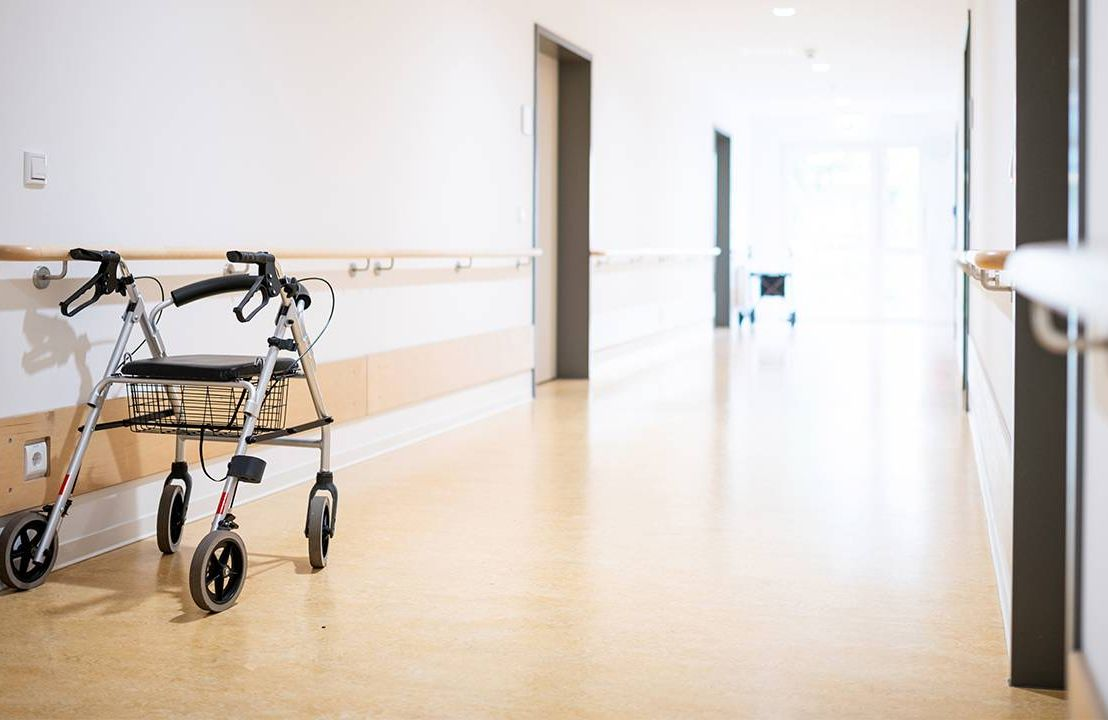 One walker waiting in the hallway of an assisted living facility. Long-term care,Next Avenue