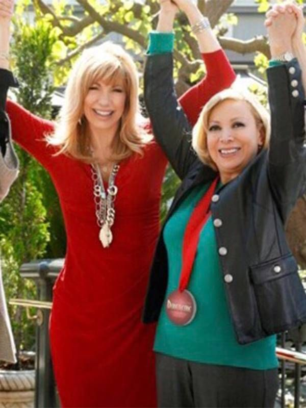 """Leeza Gibbons standing with raised arms with a """"courageous caregiver"""" outside. Caregiving, care, Next Avenue"""