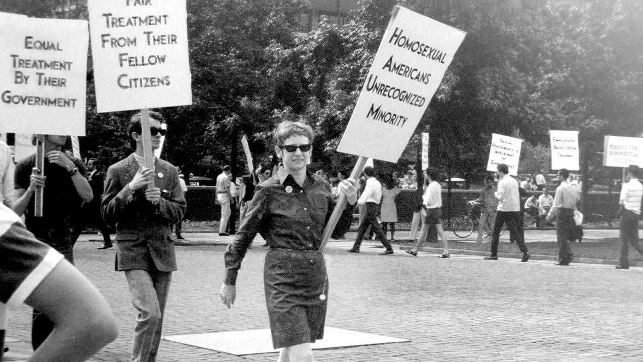 An old photograph of LGBT activists marching with signs. 'CURED' documentary, Next Avenue