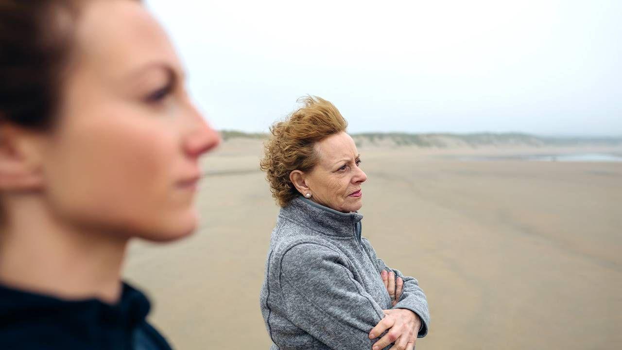 Two women walking on the beach looking serious. Estrangement, estranged, family, cutoff, Next Avenue