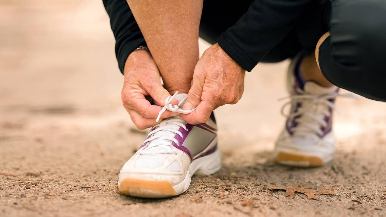 Closeup of a person tying their shoe laces. Foot health, feet health, Next Avenue