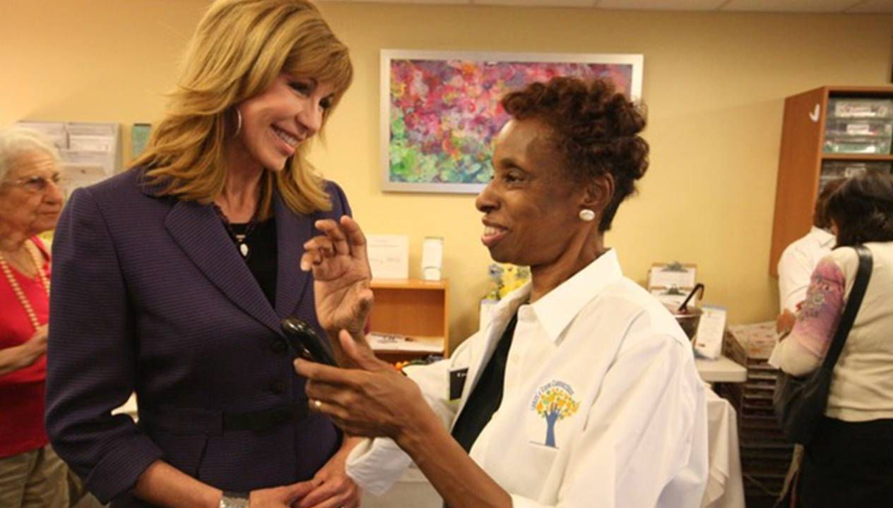 Leeza Gibbons smiling and talking with a volunteer caregiver. Caregiving, care, Leeza Gibbons, Next Avenue